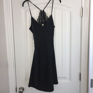 Dresses & Skirts - Black open-back dress with lace details
